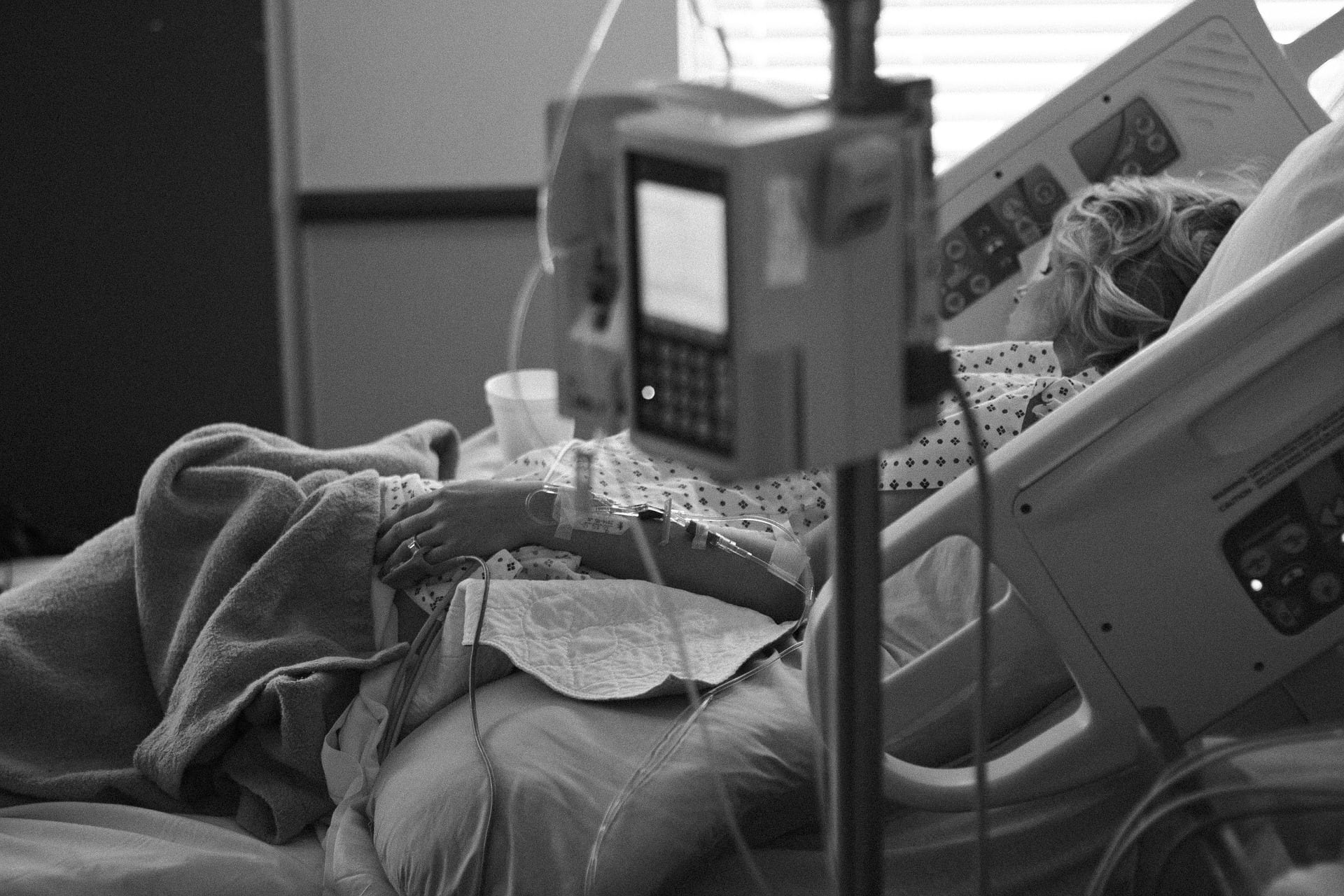 A woman pictured in a hospital bed. BIA-ALCL lawsuits are on the rise.