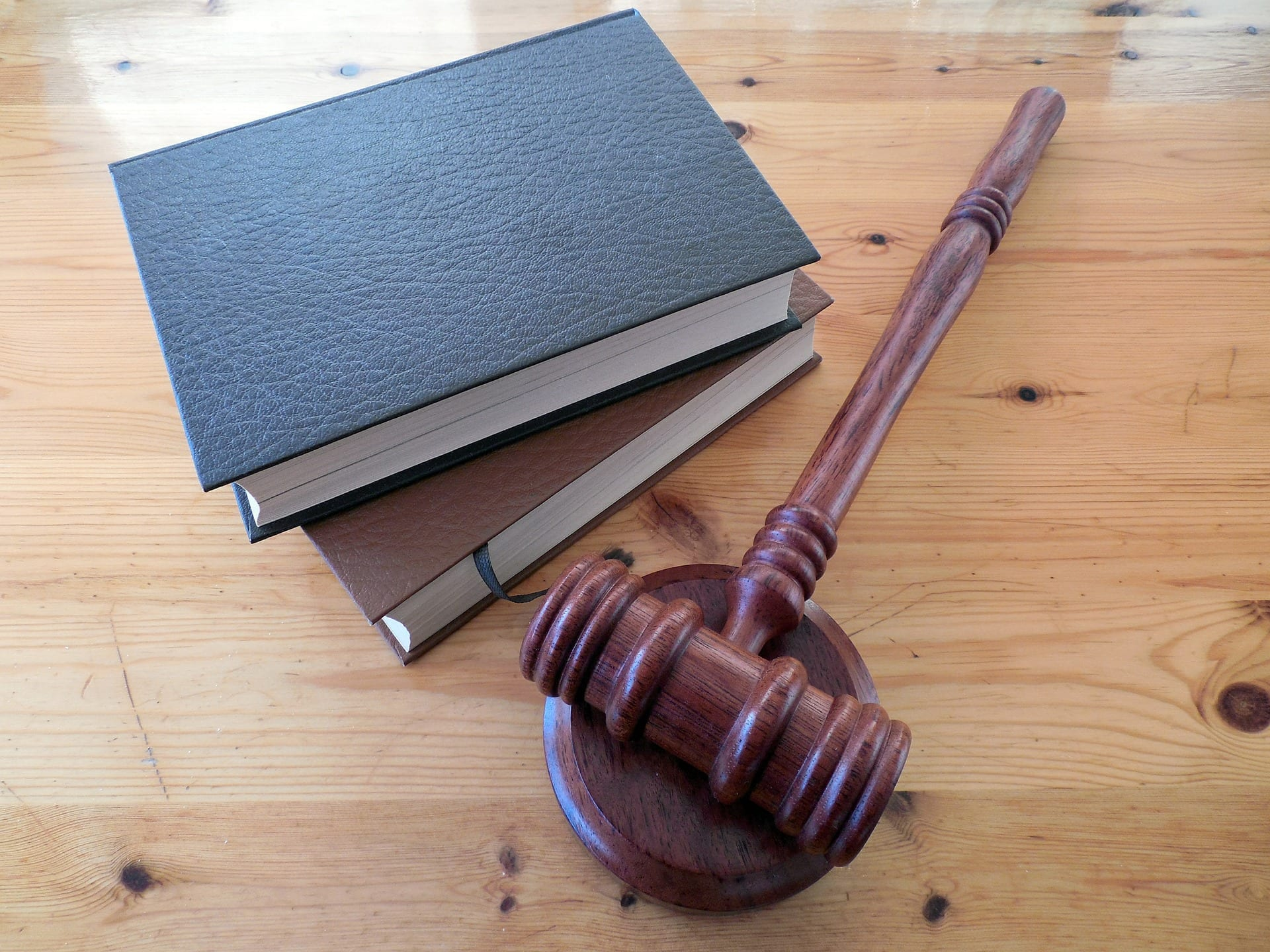 law books and a gavel on a table