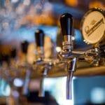 Row of beer taps.