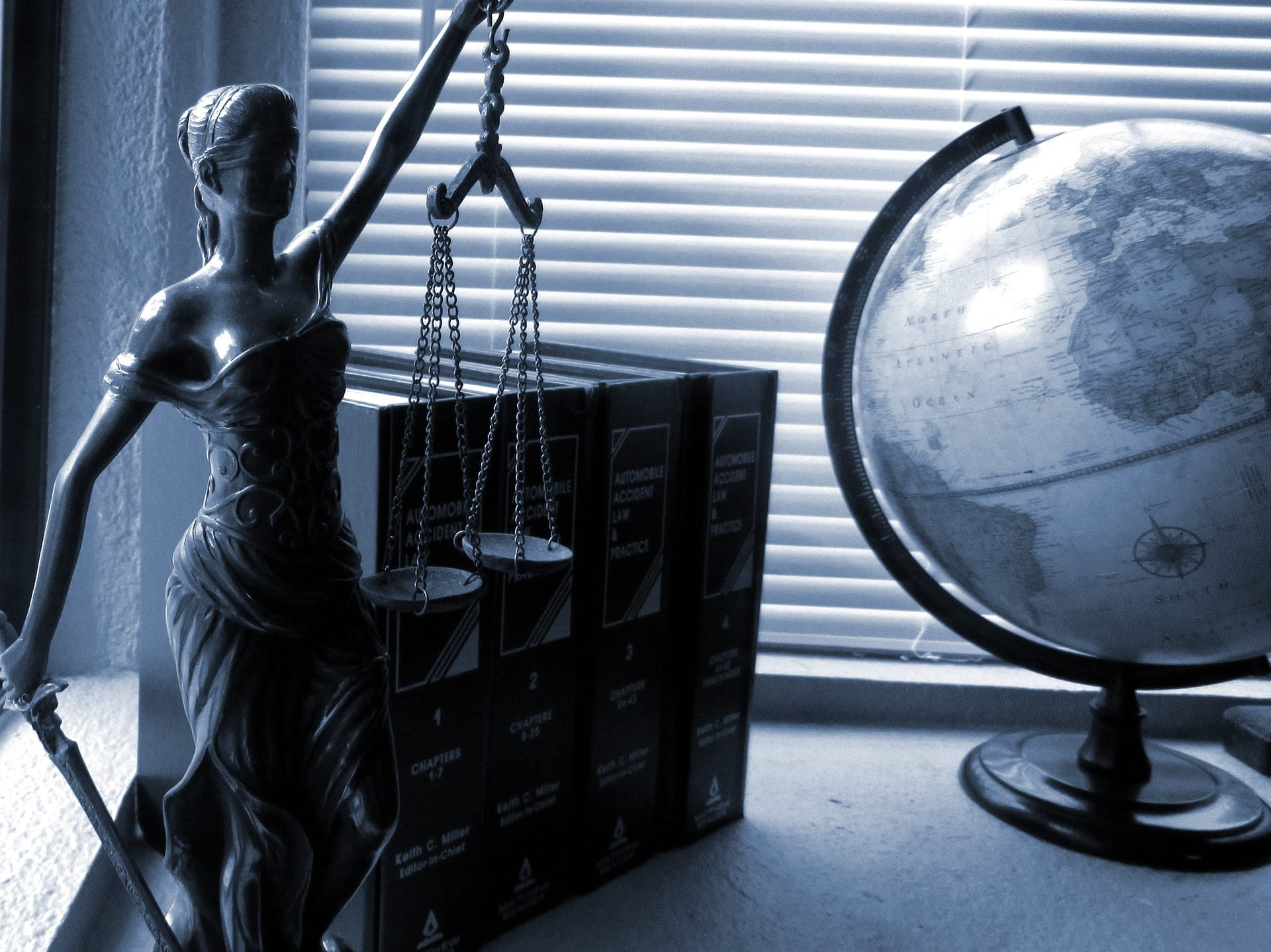 Lady Justice statue with scales and globe.