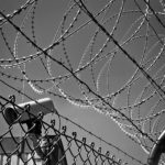 Barbed wire prison fence