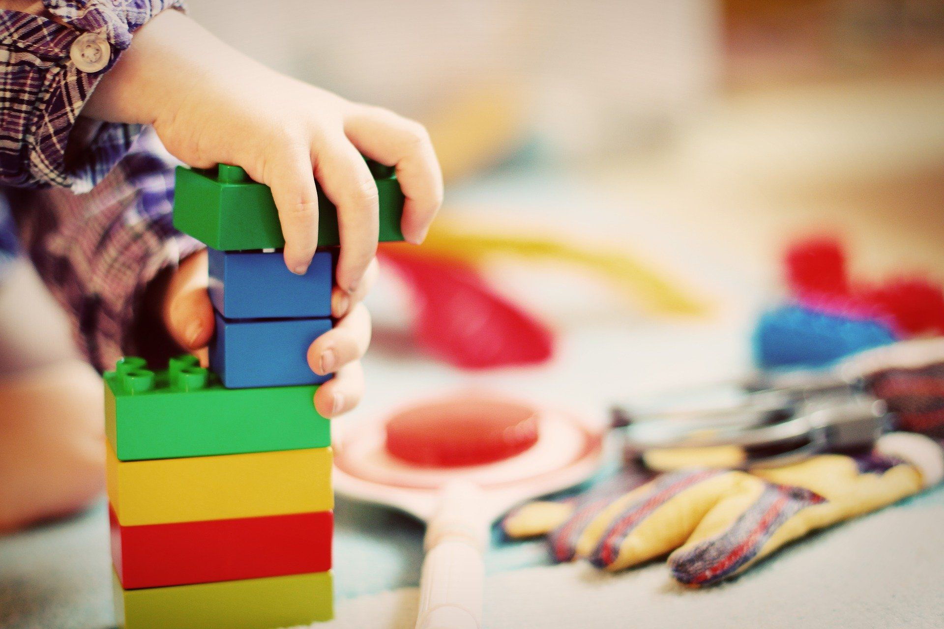 A child playing with small toy blocks.